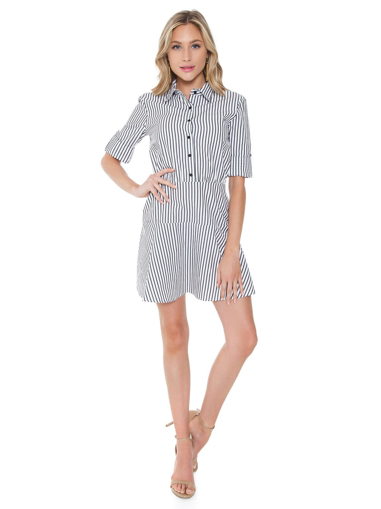 Woman wearing a dress rental from BB Dakota called Layla Mini Spot Wrap Dress