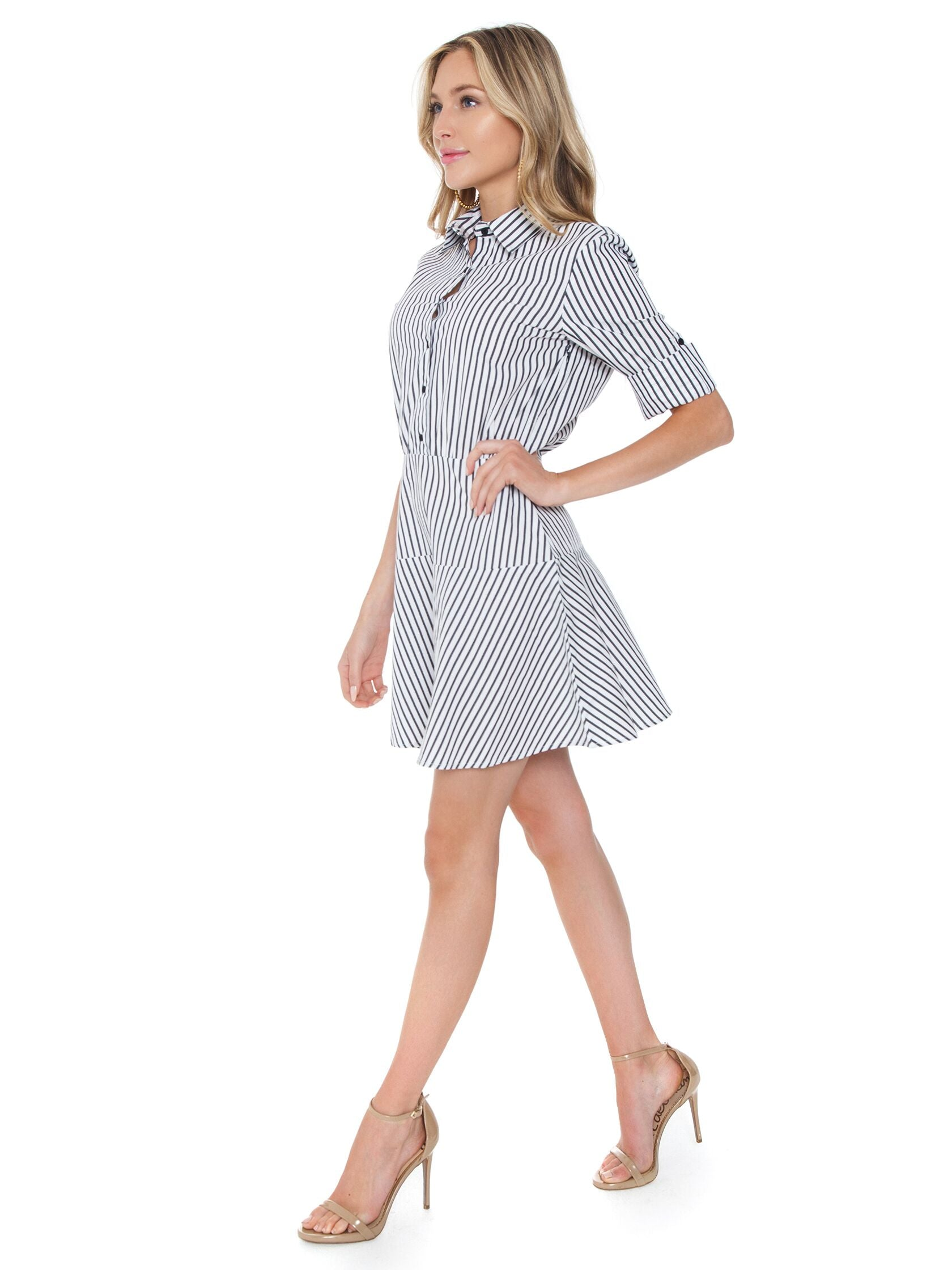 Woman wearing a dress rental from BB Dakota called Shirt Notice Stripe Dress With Roll-up Sleeve
