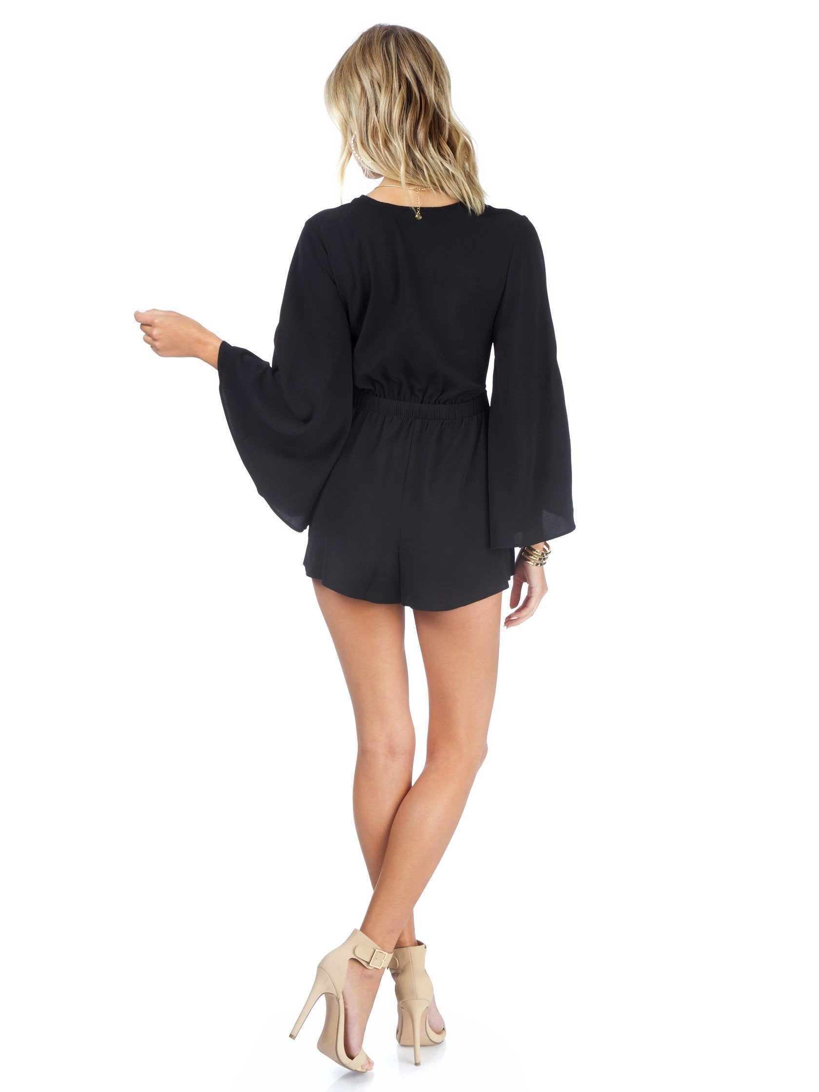 Women wearing a romper rental from Show Me Your Mumu called Charleston Romper
