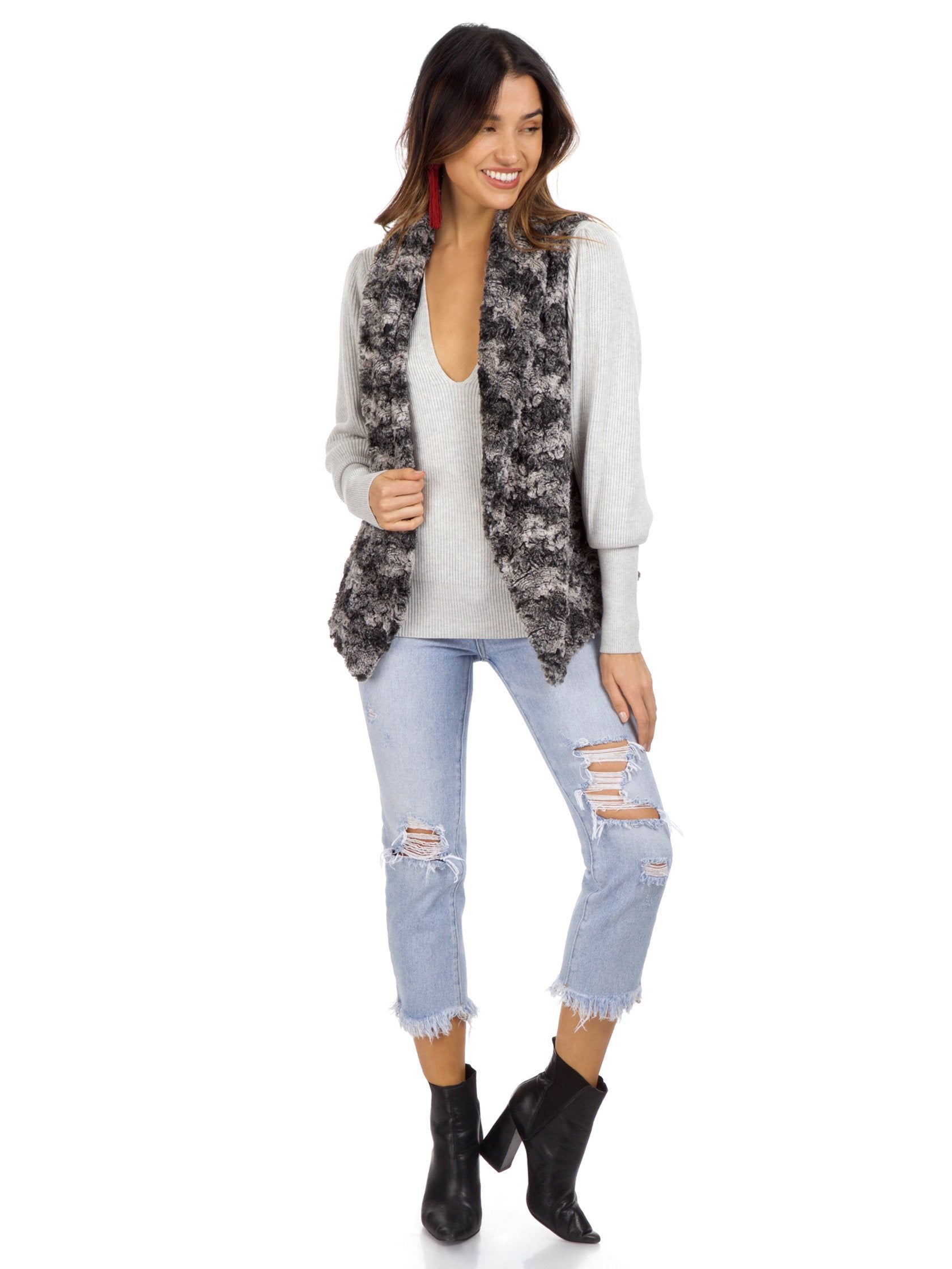Women outfit in a vest rental from Show Me Your Mumu called Fausta Vest Wolfpack Faux Fur Vest