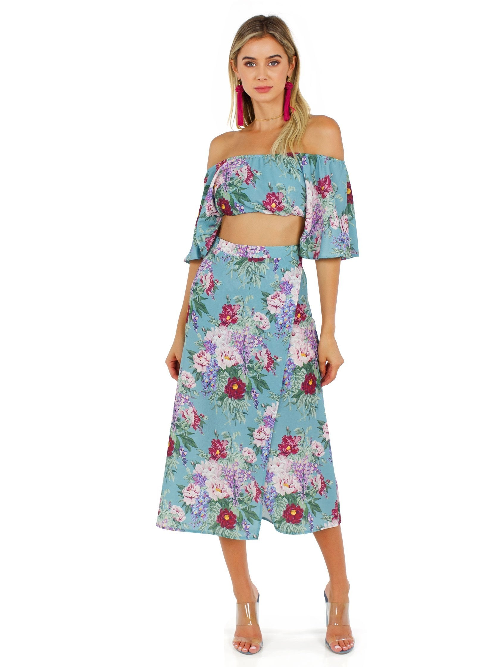 Women wearing a two piece rental from Show Me Your Mumu called Heidi Ruffle Crop And Flirt Skirt