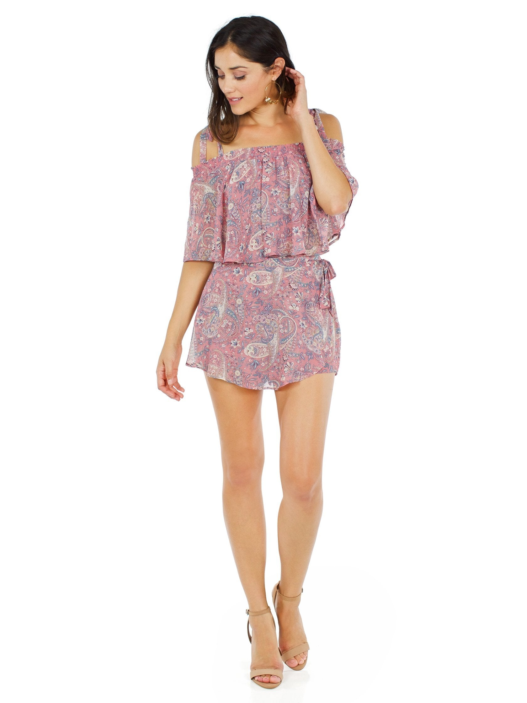 Woman wearing a top rental from Show Me Your Mumu called Nini Tie Top & Great Wrap Skort Set