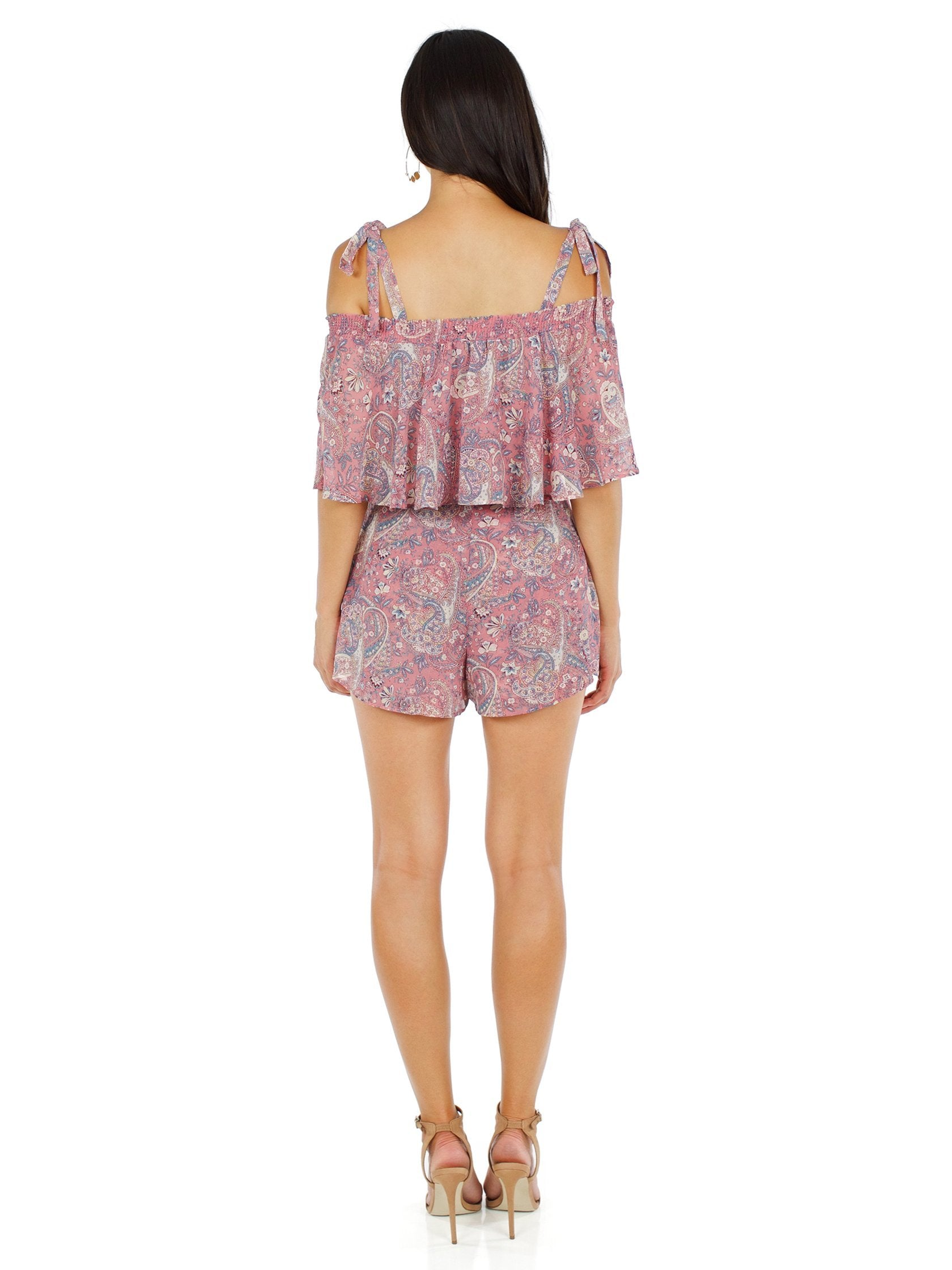 Women outfit in a top rental from Show Me Your Mumu called Nini Tie Top & Great Wrap Skort Set