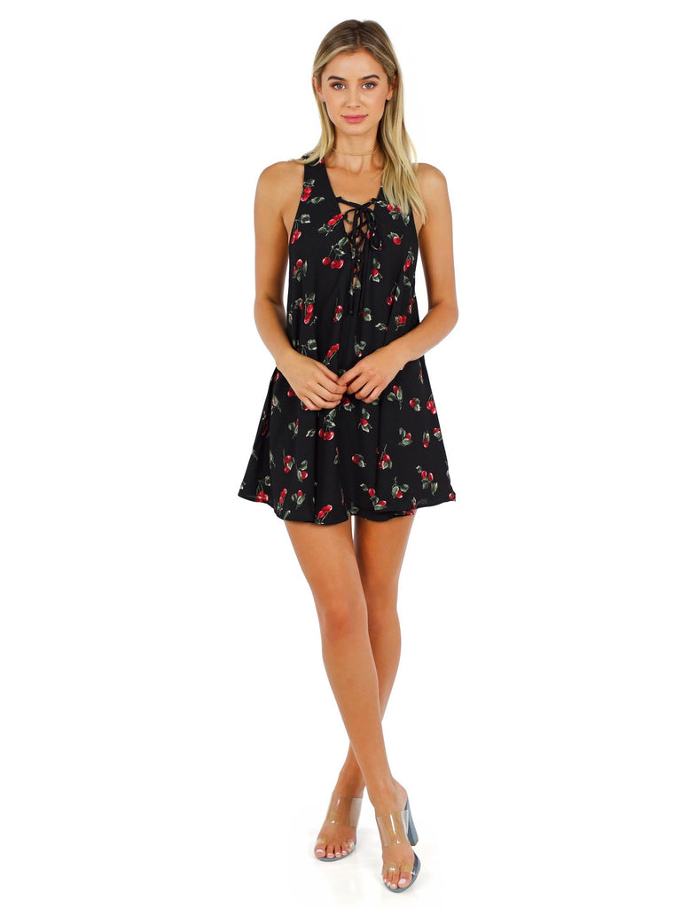 Women wearing a dress rental from Show Me Your Mumu called Rancho Mirage Lace Up Tunic Dress