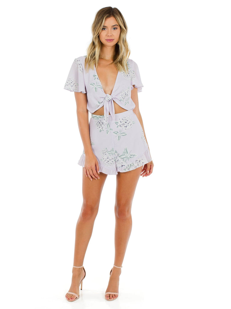Girl wearing a romper rental from Show Me Your Mumu called Donovan Crop Top