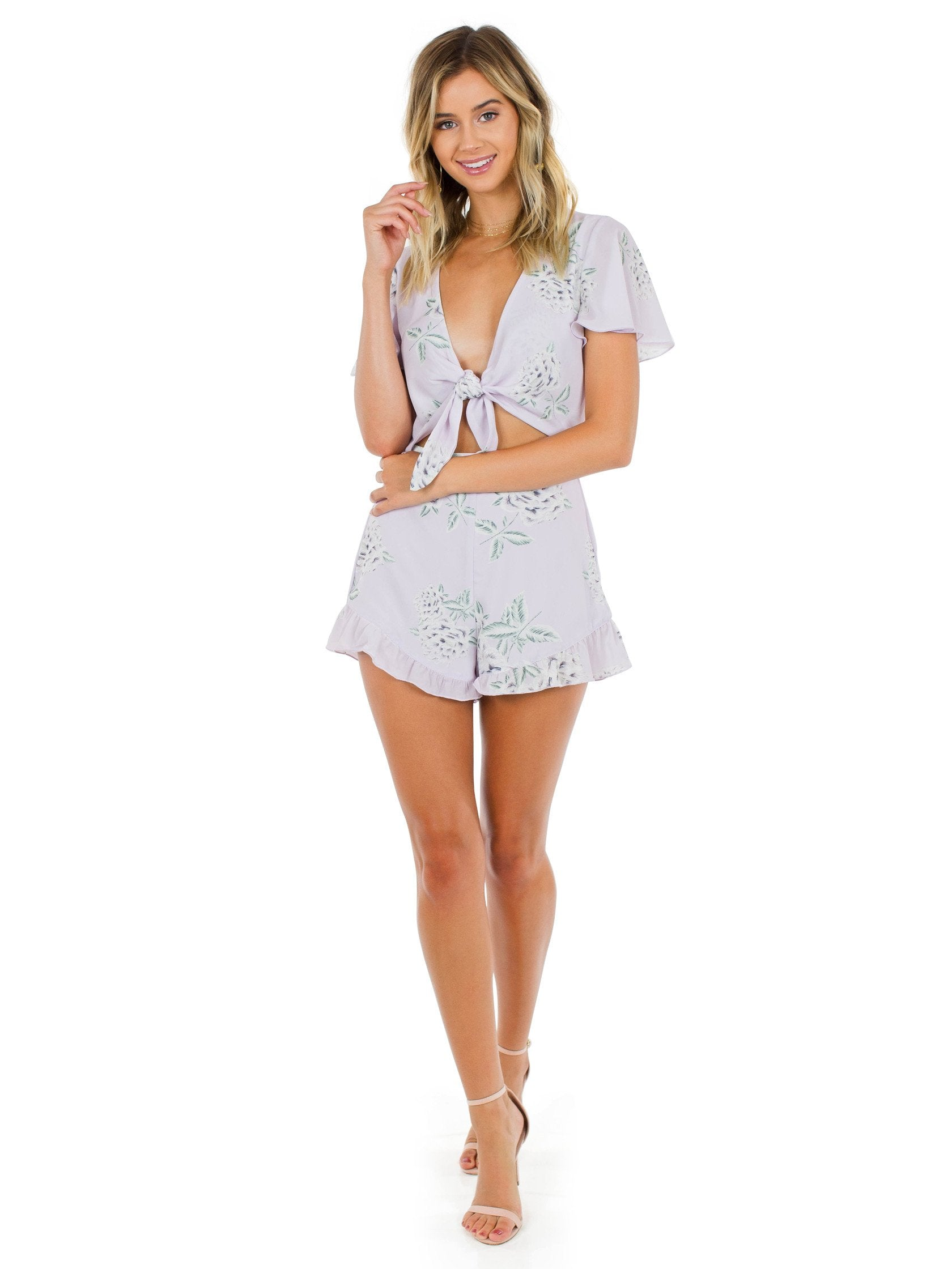 Women wearing a romper rental from Show Me Your Mumu called Riviera Romper