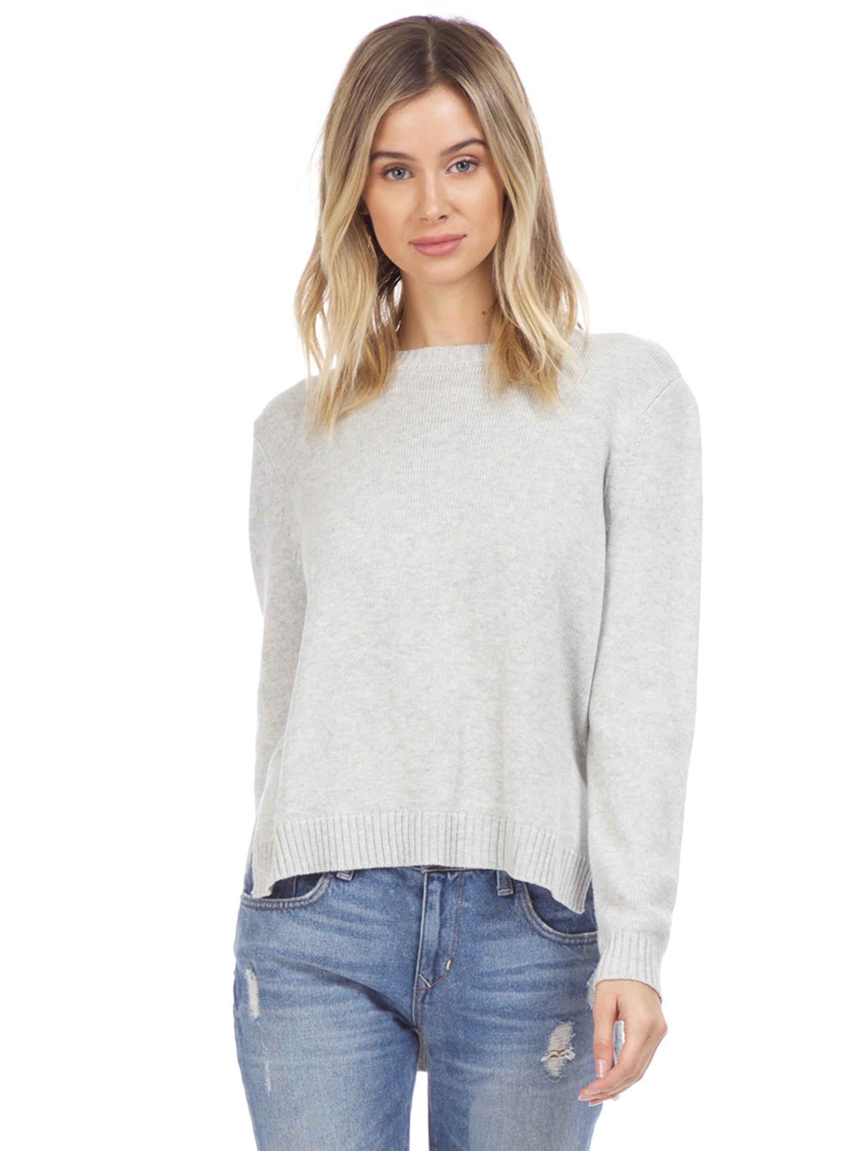 Woman wearing a sweater rental from Six Crisp Days called High Low Sweater