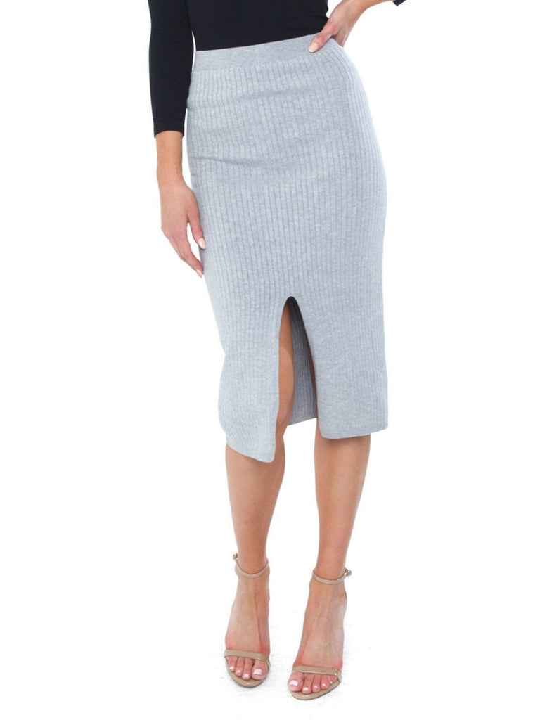Women wearing a skirt rental from Free People called Get A Crew Sweater