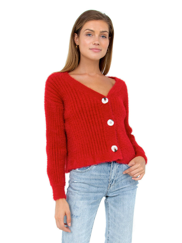 Women wearing a cardigan rental from MINKPINK called Skylar Red Cardi