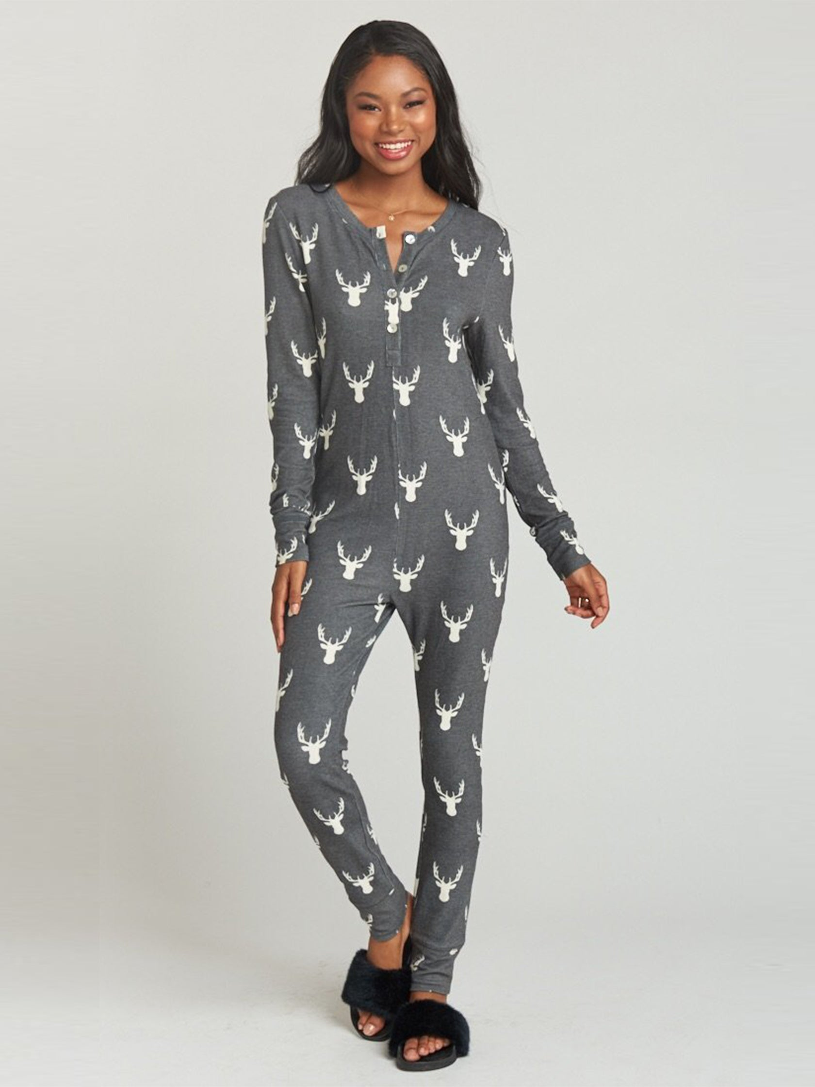 Woman wearing a pajamas rental from Show Me Your Mumu called Sleepy Time Onesie