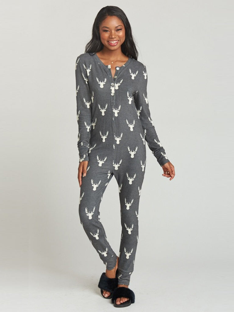 Girl wearing a pajamas rental from Show Me Your Mumu called Cozy Up With Me Bodysuit