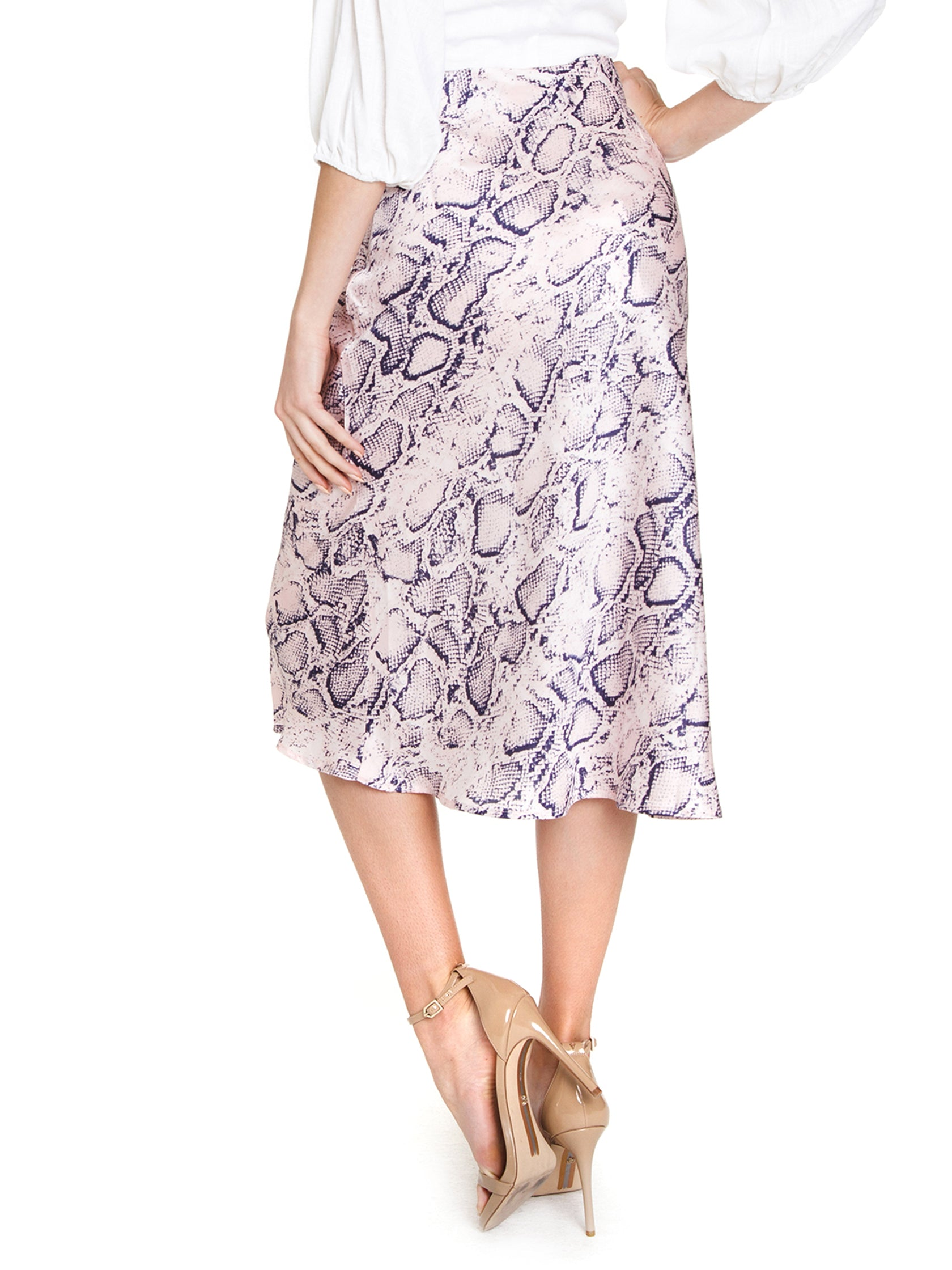 Women outfit in a skirt rental from FashionPass called Snakeskin Midi Skirt