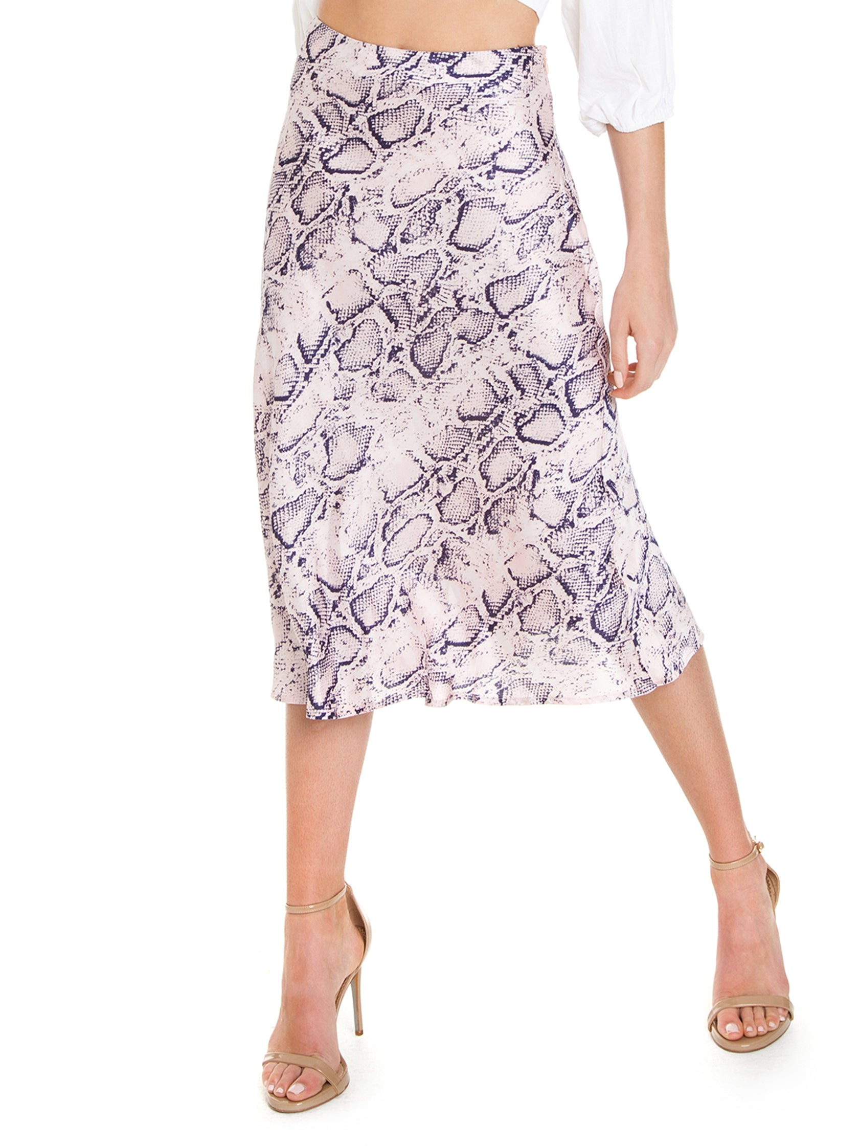 Woman wearing a skirt rental from FashionPass called Snakeskin Midi Skirt
