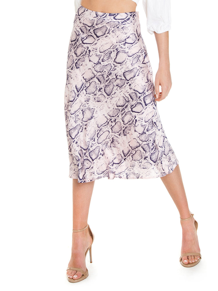 Women wearing a skirt rental from FashionPass called Snakeskin Midi Skirt