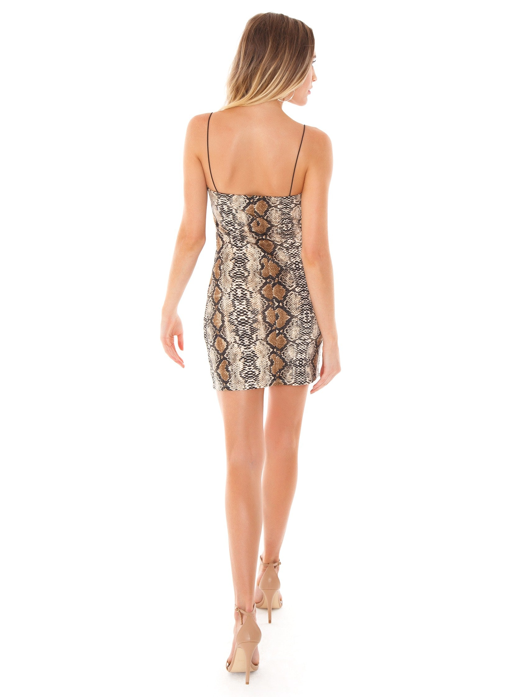 Women wearing a dress rental from FashionPass called Snakeskin Mini Dress