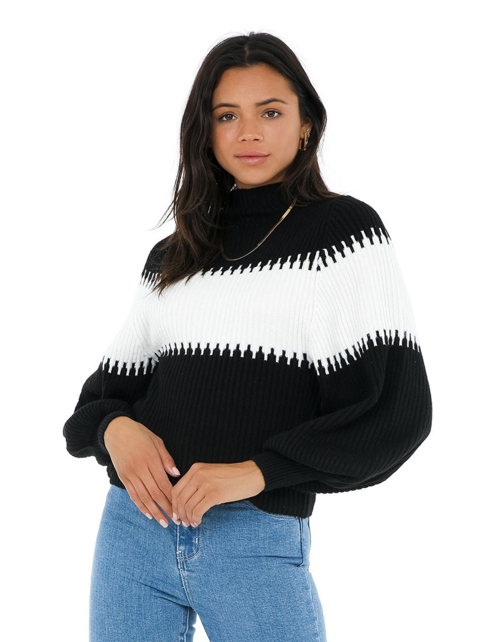 Woman wearing a sweater rental from French Connection called Sofia Knits Balloon Sleeve Jumper