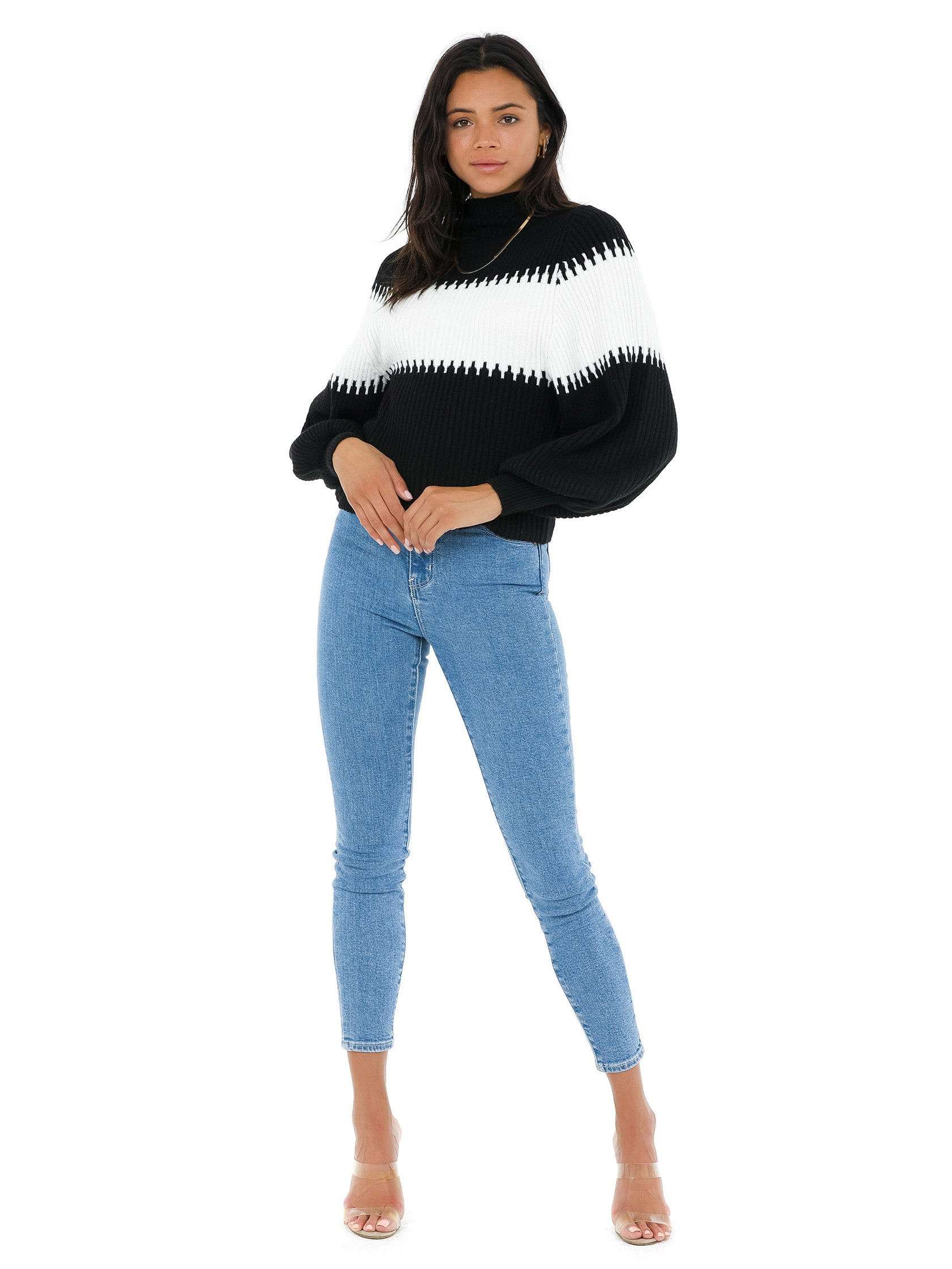 Girl wearing a sweater rental from French Connection called Sofia Knits Balloon Sleeve Jumper