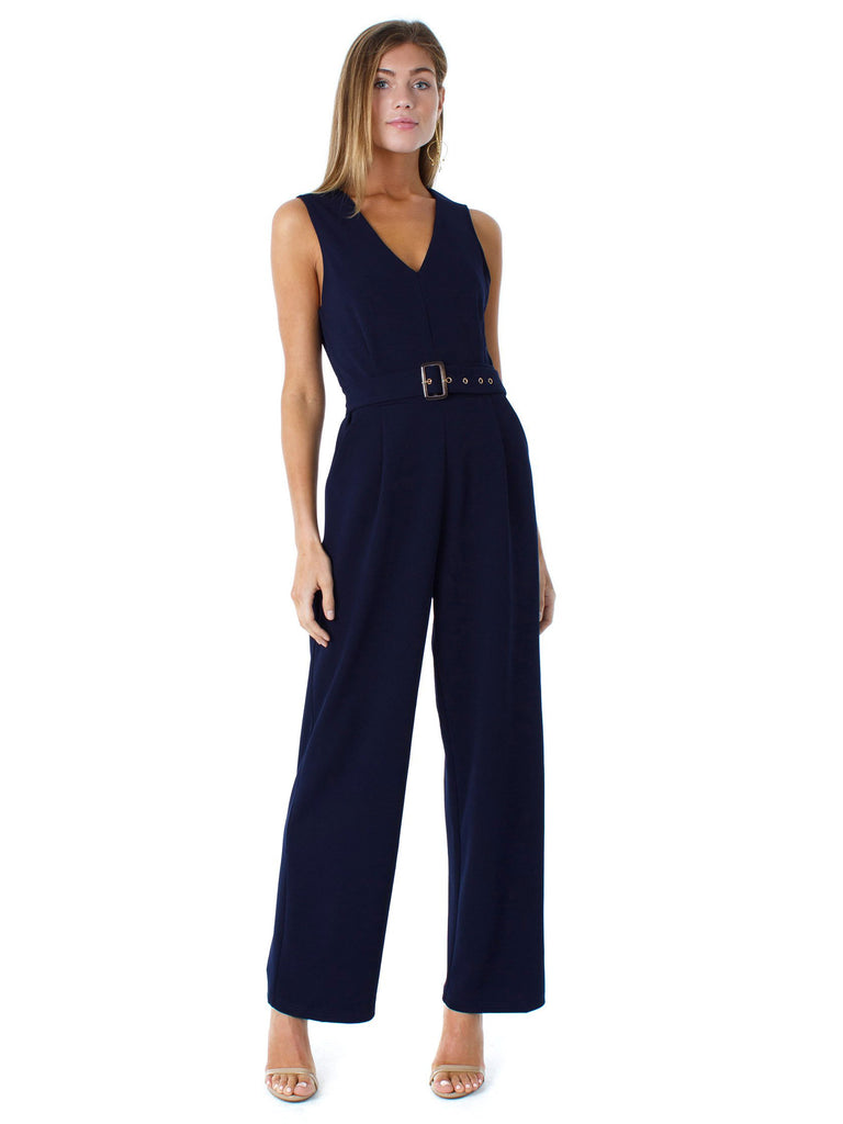 Woman wearing a jumpsuit rental from Bishop + Young called Kairi Dress