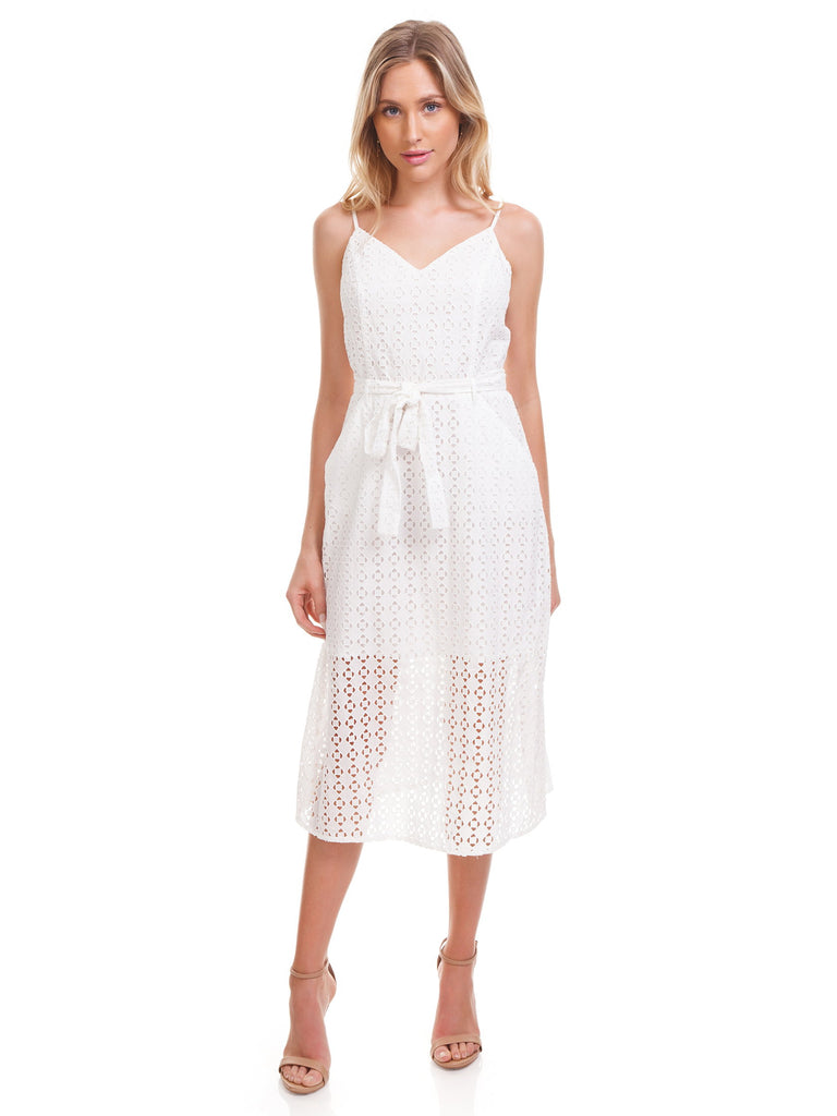 Women wearing a dress rental from Ali & Jay called Shutters Sunsets Cotton Eyelet Midi Dress