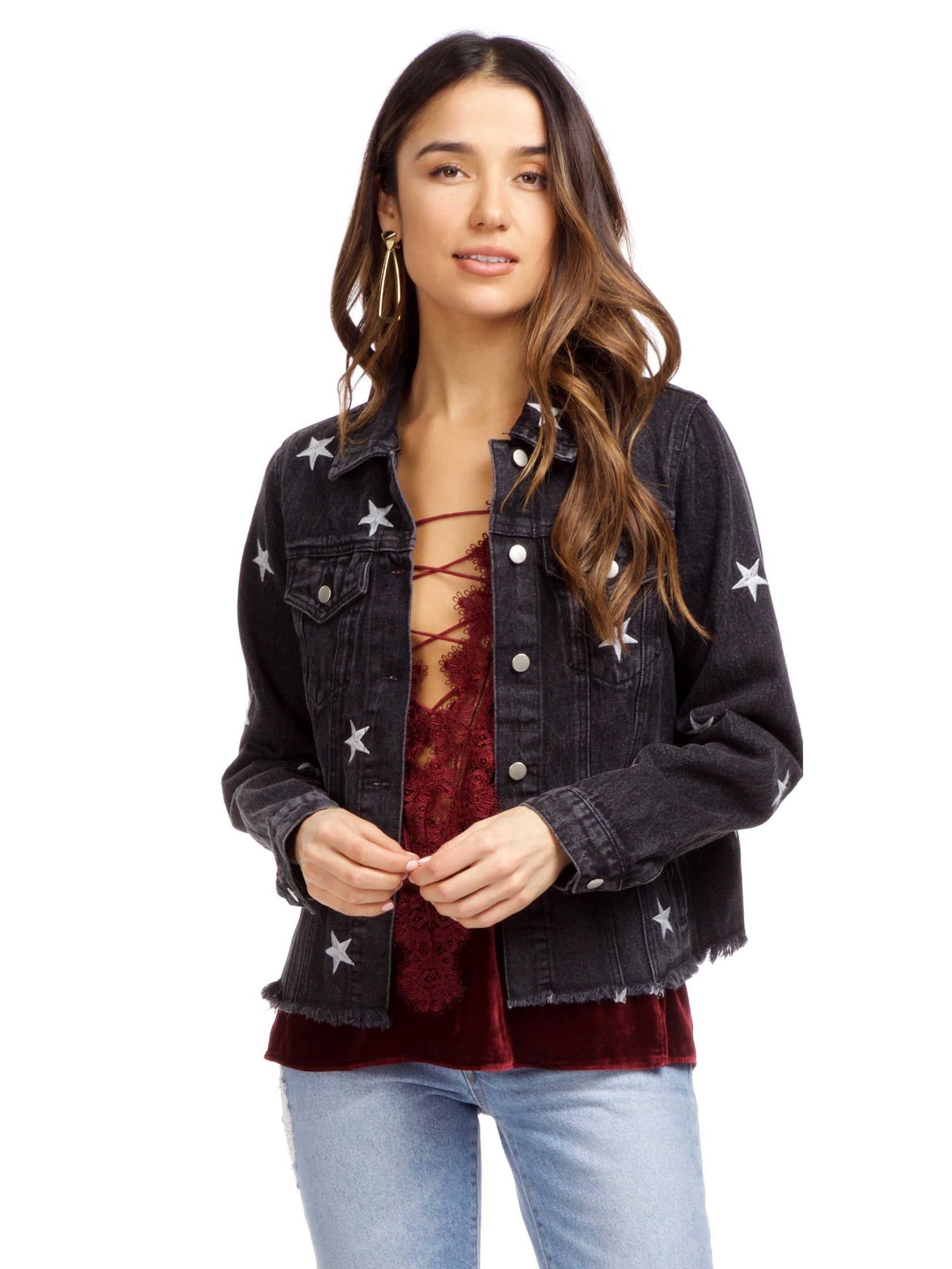 Woman wearing a jacket rental from FashionPass called Stardust Denim Jacket