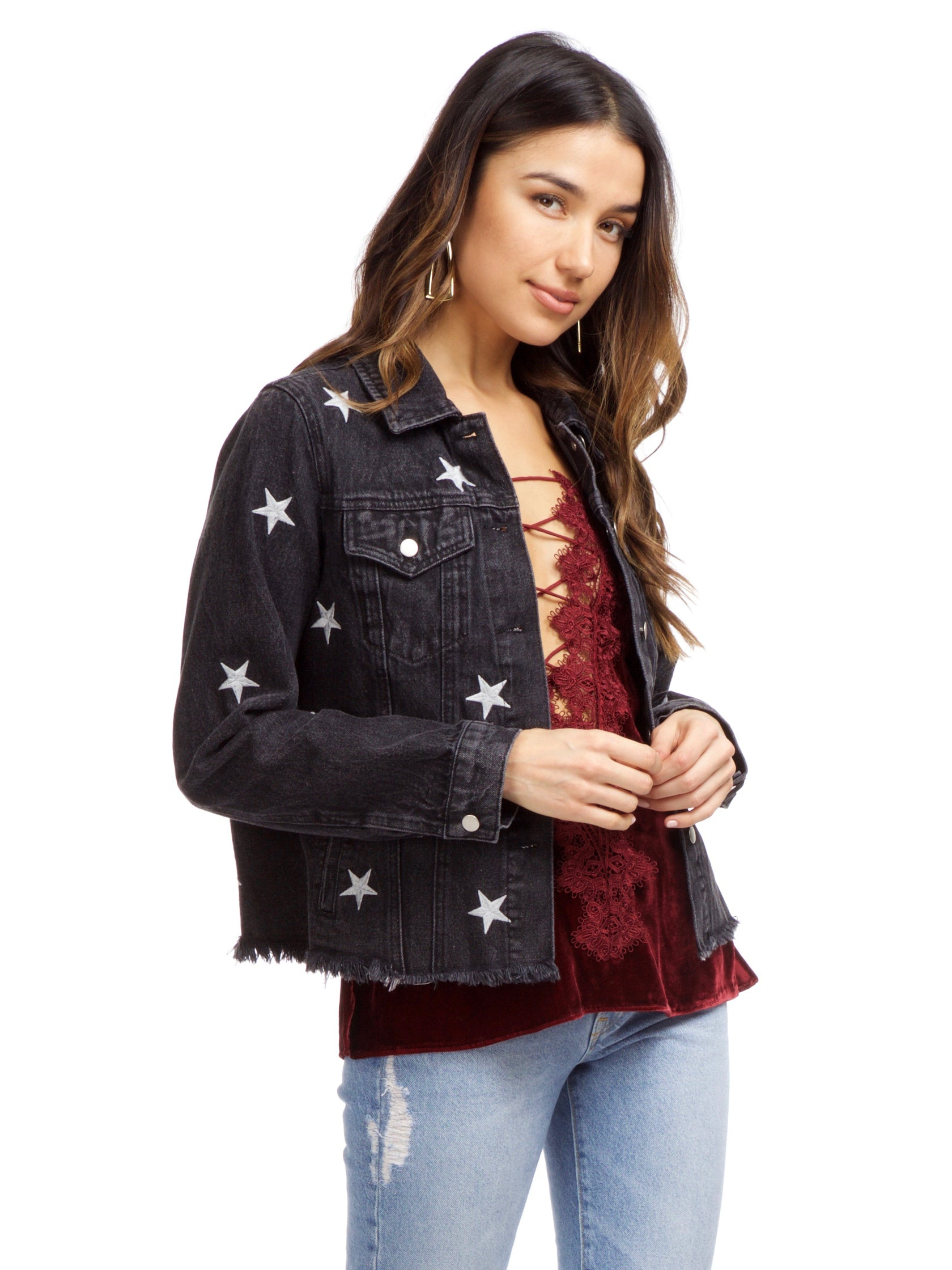 Women wearing a jacket rental from FashionPass called Stardust Denim Jacket
