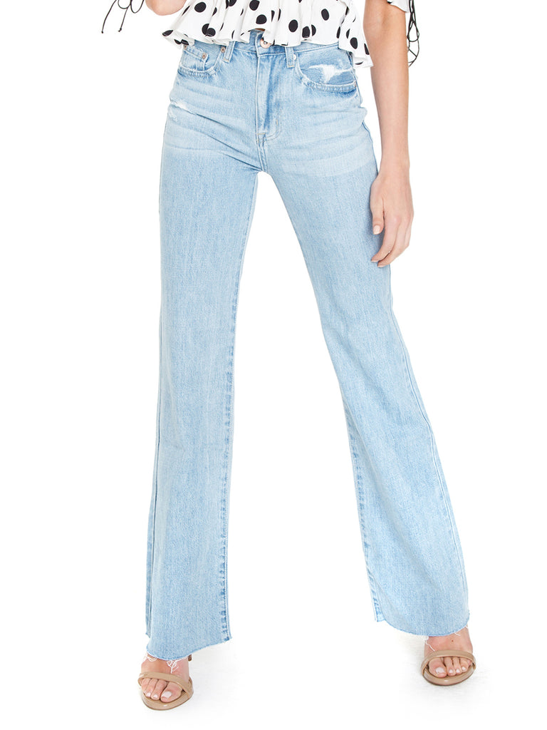 Woman wearing a pants rental from PISTOLA called Presley High Rise Girlfriend Jeans