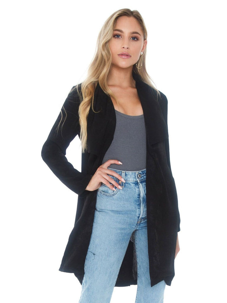 Women outfit in a jacket rental from SAGE THE LABEL called Elle Long Sleeve Snap Front Shirt