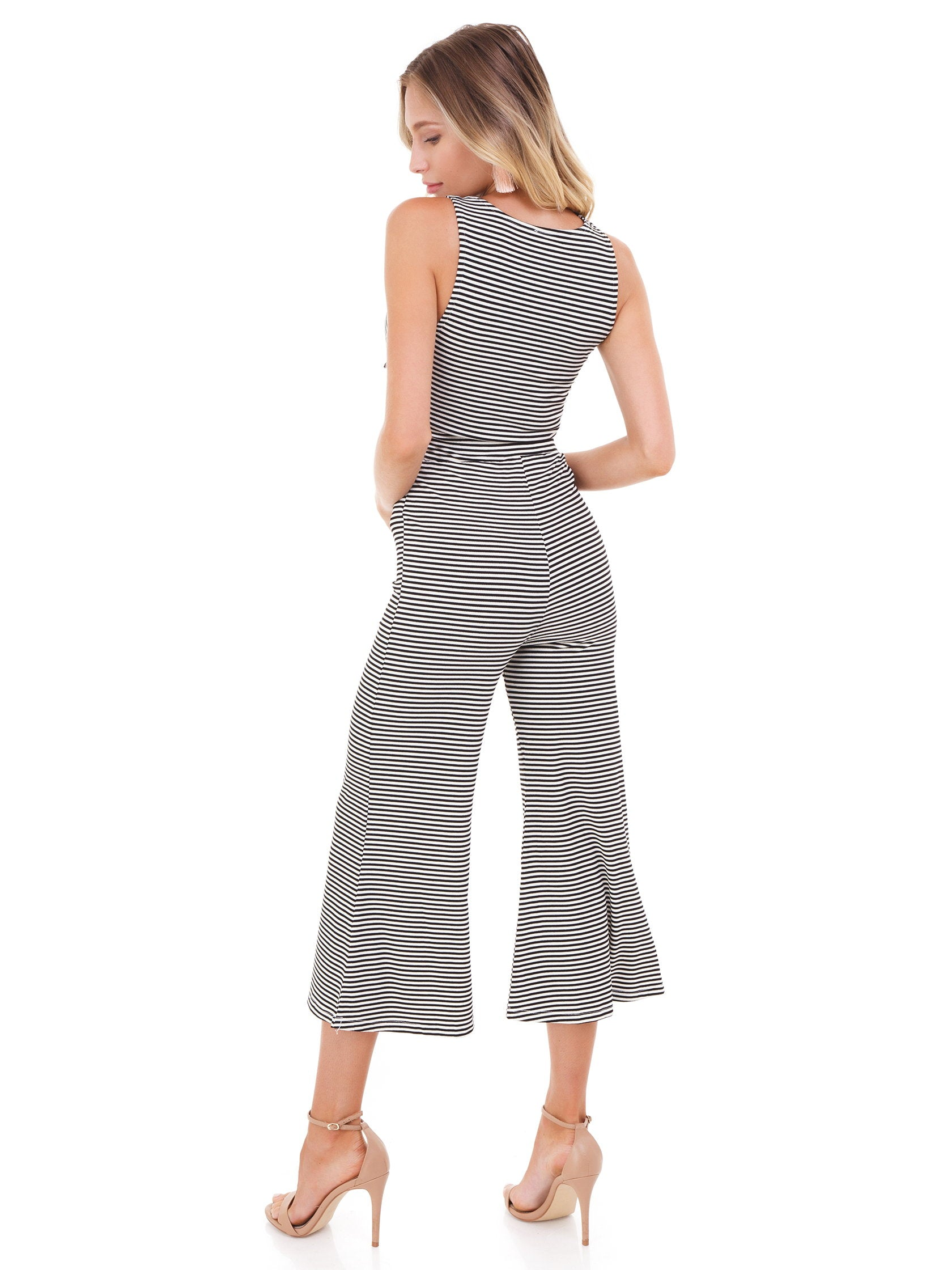 Women wearing a jumpsuit rental from FashionPass called Stripe Cropped Jumpsuit