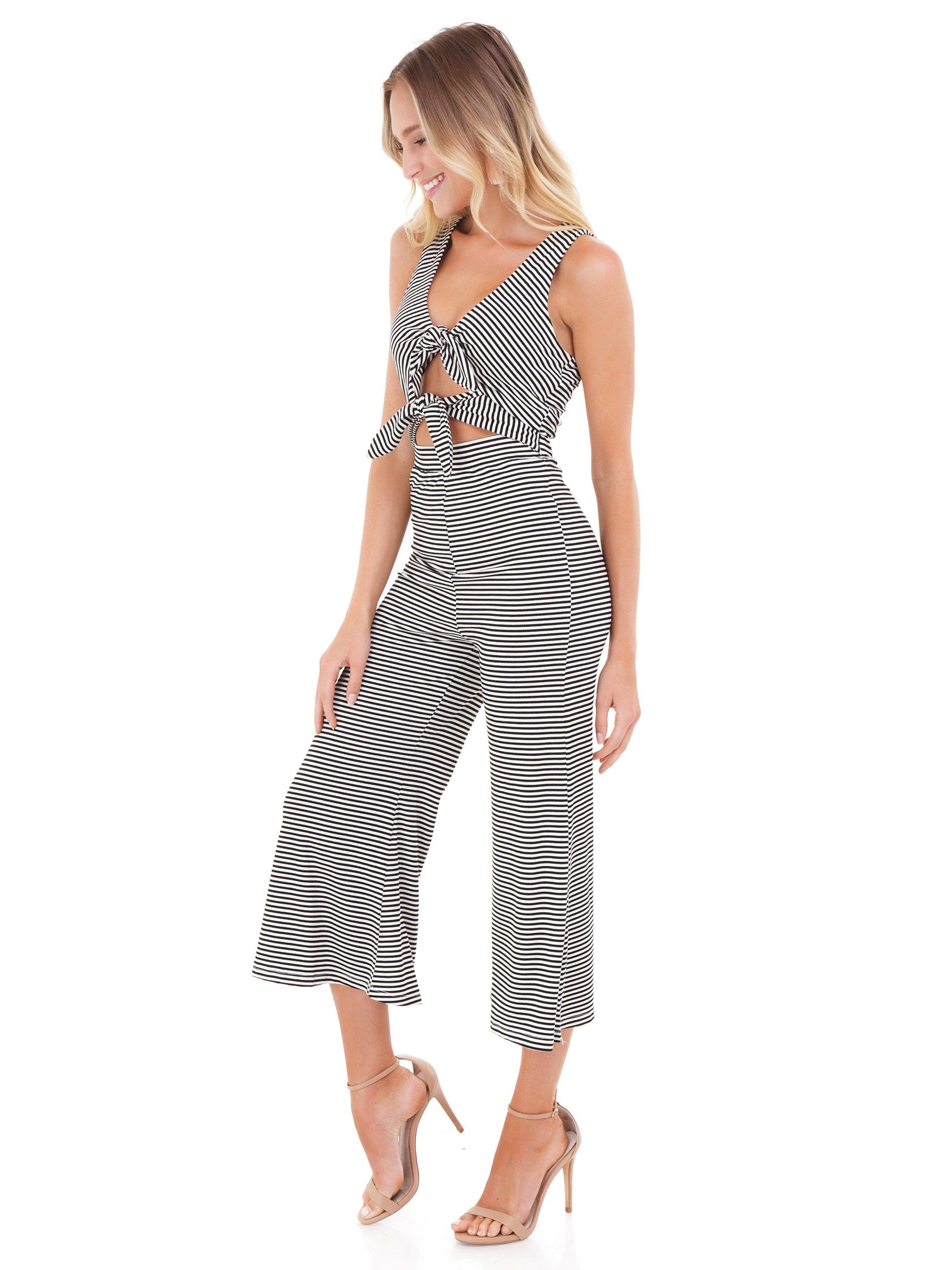 Woman wearing a jumpsuit rental from FashionPass called Stripe Cropped Jumpsuit