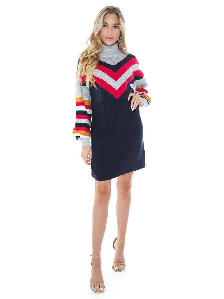 Women wearing a dress rental from MINKPINK called Stripe Me Up Sweater Dress