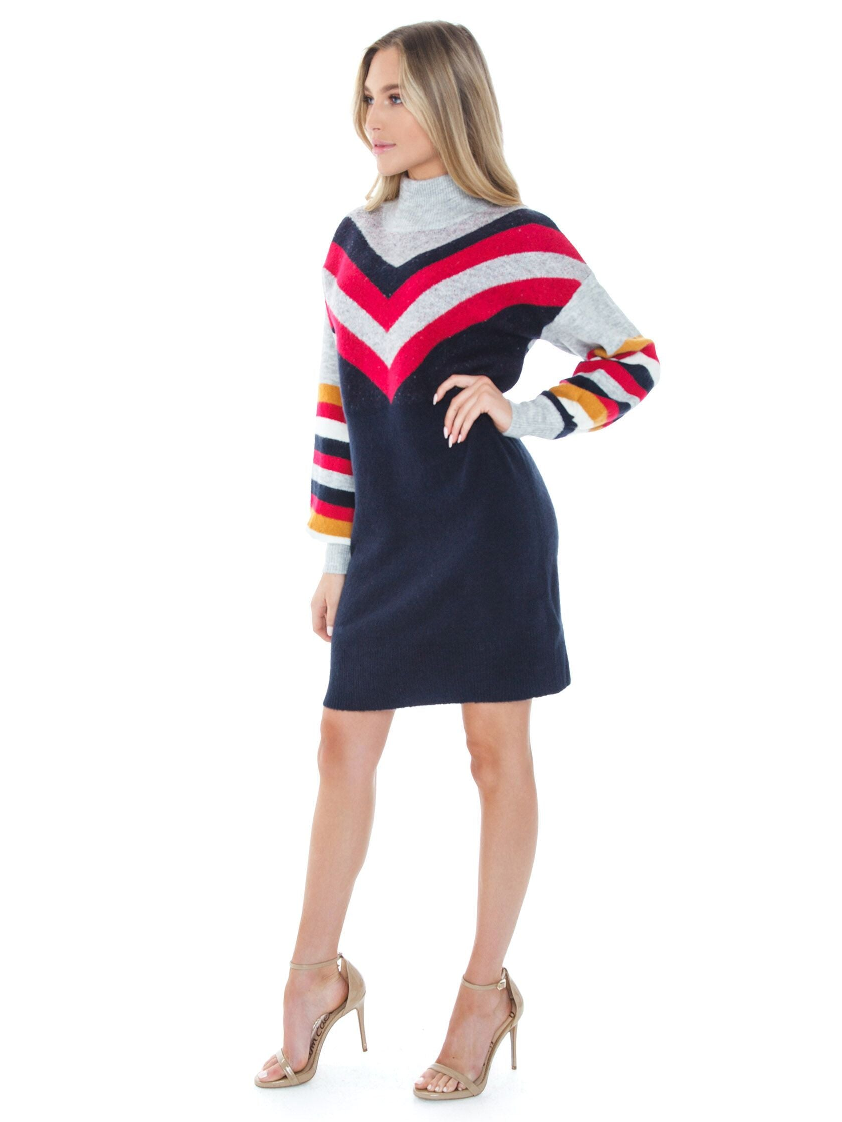 Woman wearing a dress rental from MINKPINK called Stripe Me Up Sweater Dress