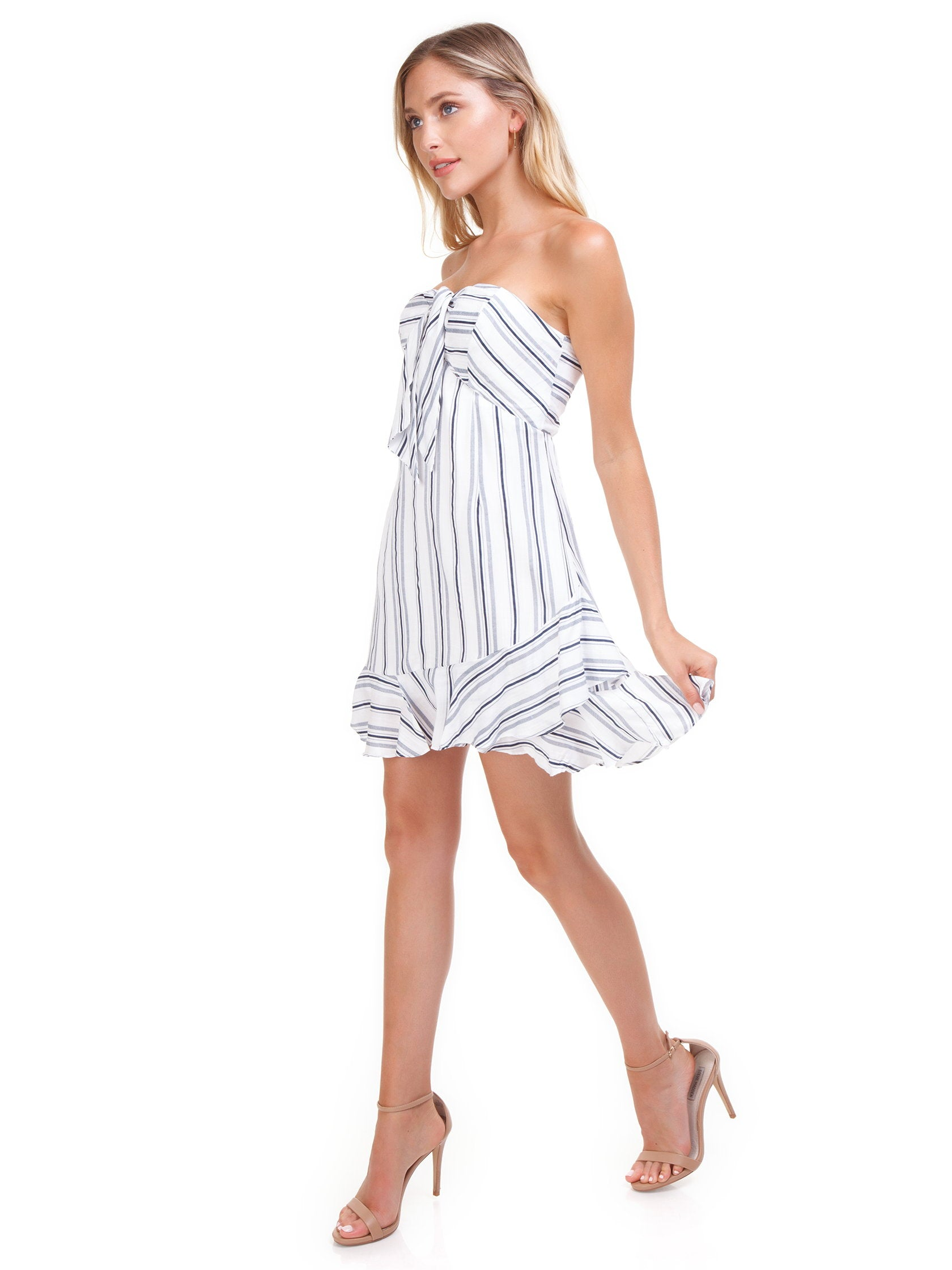 Woman wearing a dress rental from Cotton Candy called Stripe Mini Dress