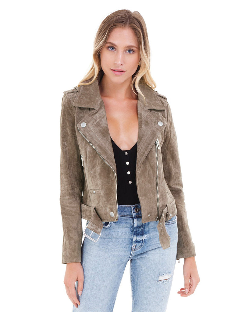 Women wearing a jacket rental from BLANKNYC called Presley High Rise Girlfriend Jeans