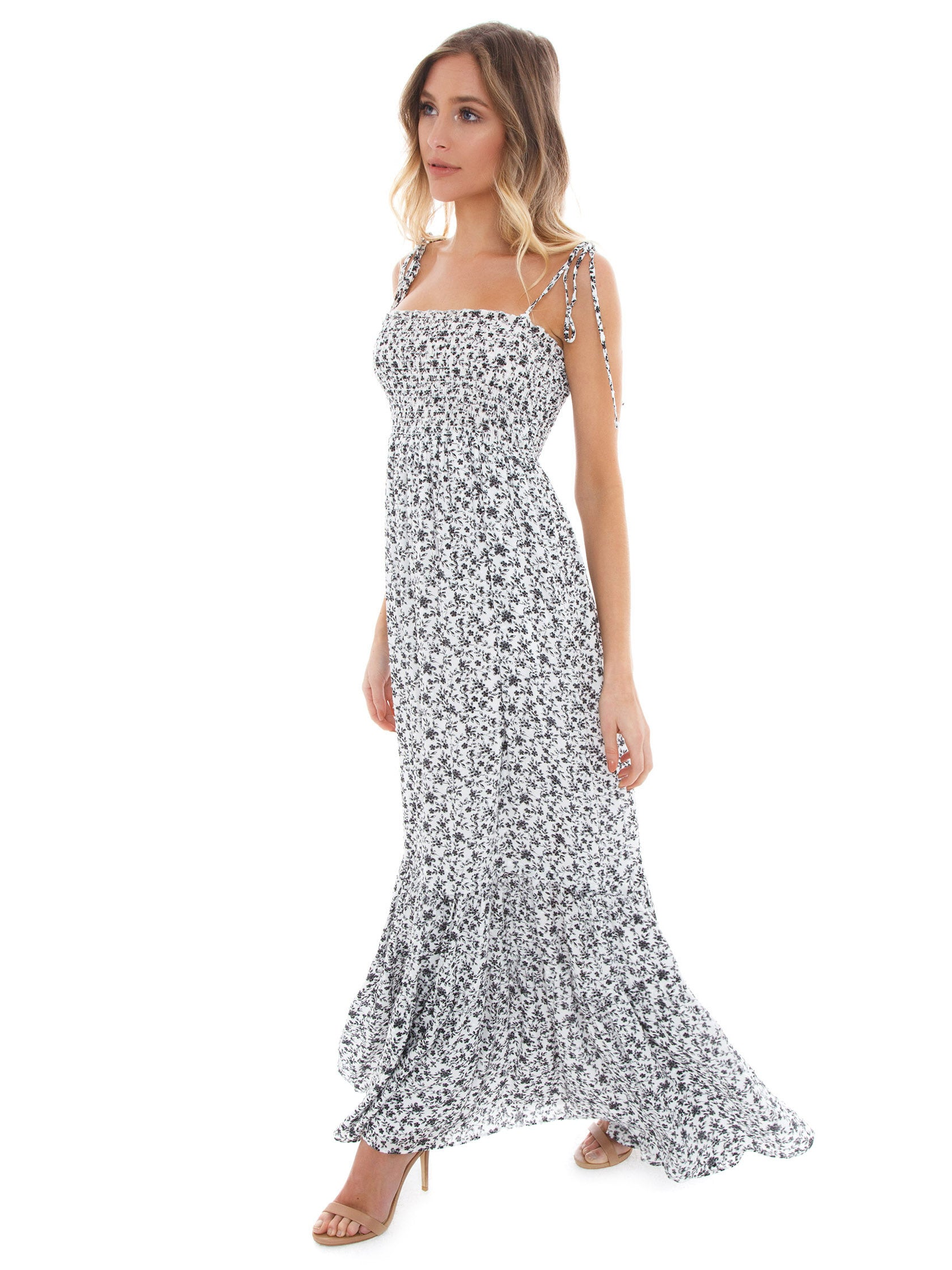 Woman wearing a dress rental from Blue Life called Summer Breeze Maxi Dress