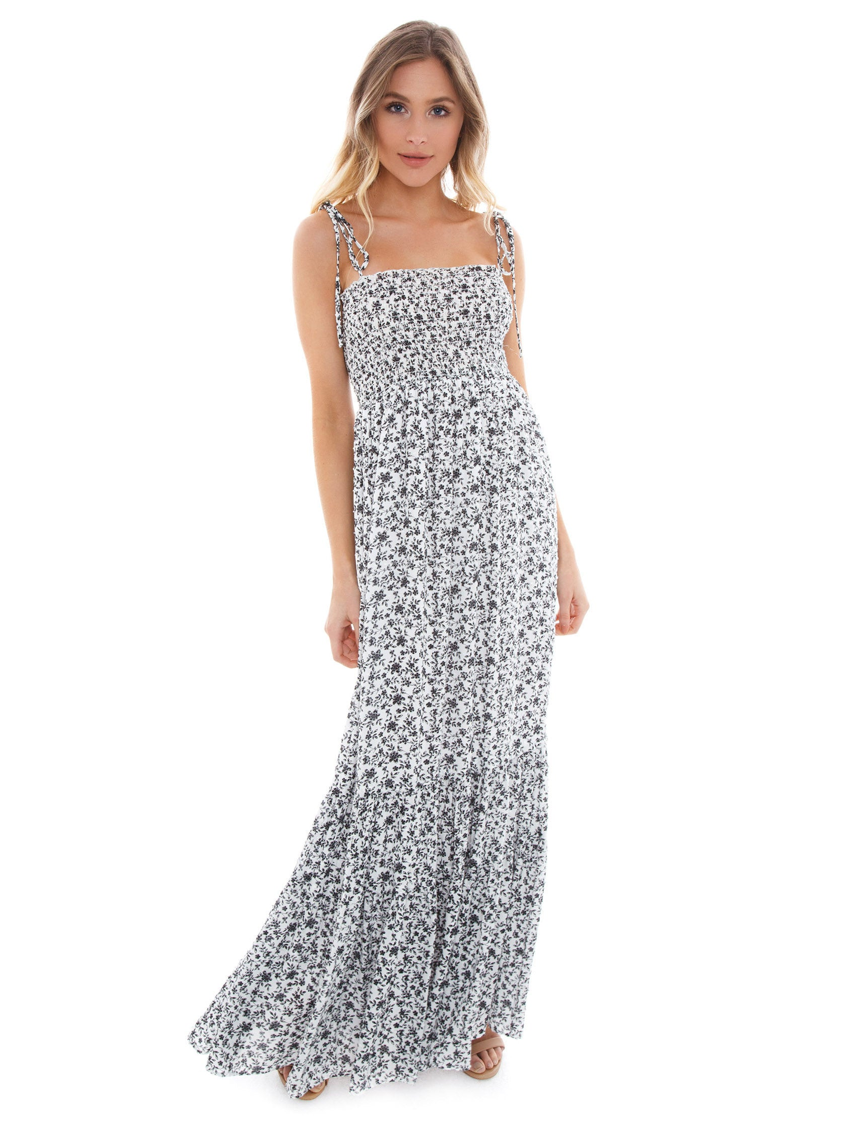 Girl outfit in a dress rental from Blue Life called Summer Breeze Maxi Dress