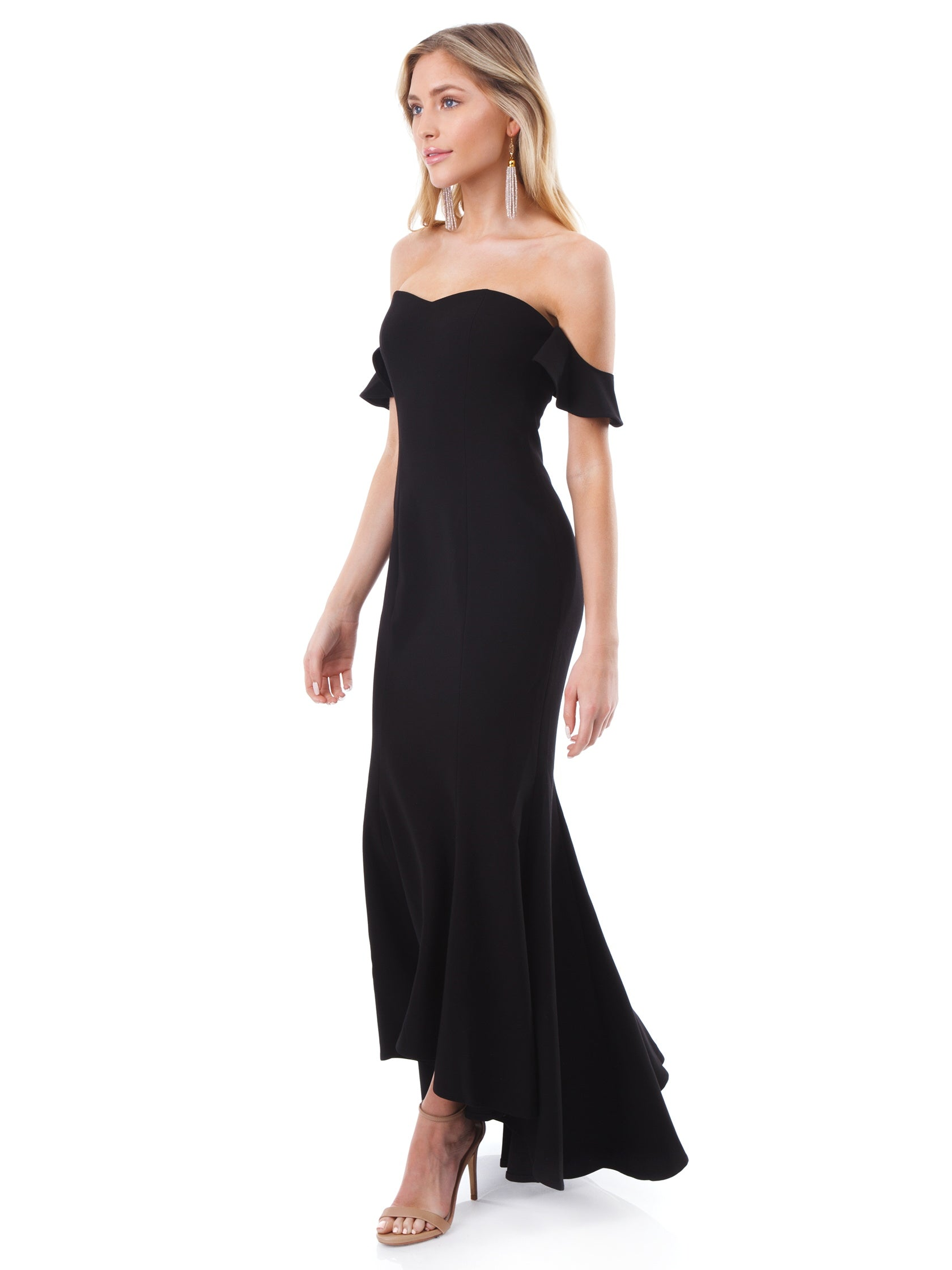 45a180ac4cca Woman wearing a dress rental from LIKELY called Sunset Gown