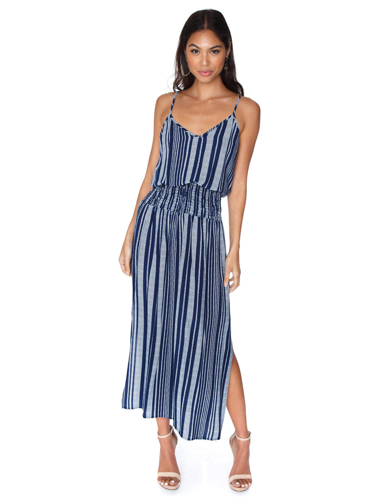 Women wearing a dress rental from Blue Life called Ruffle Cold Shoulder Dress