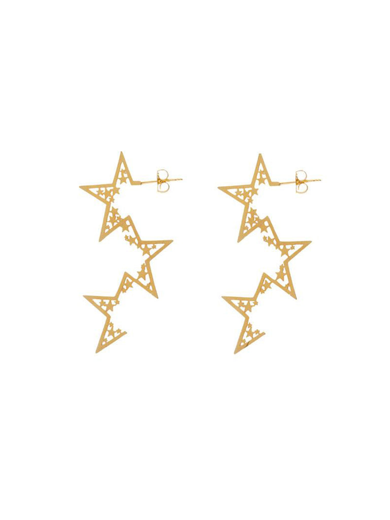Women wearing a earrings rental from Wanderlust + Co called Zodiac Gold Ring (select Your Sign)