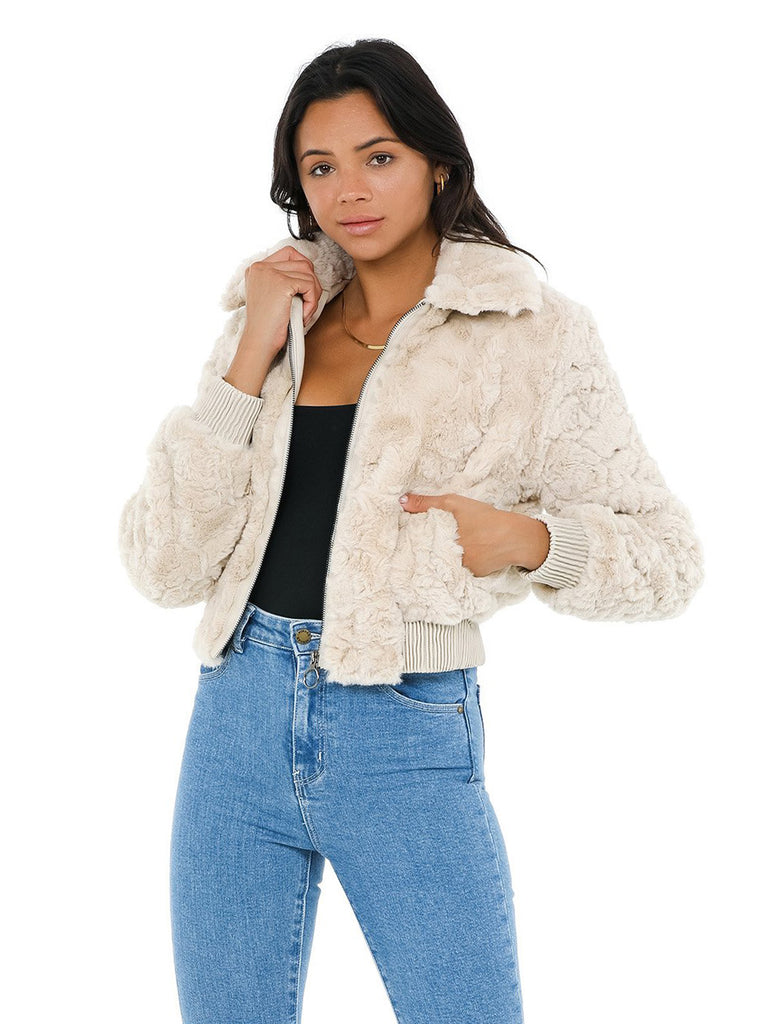 Women wearing a jacket rental from ASTR called Suzanne Faux Fur Jacket