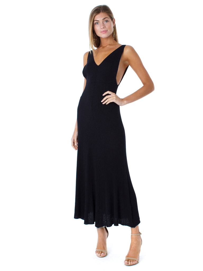 Girl outfit in a dress rental from Free People called Harley Zipper Maxi Dress
