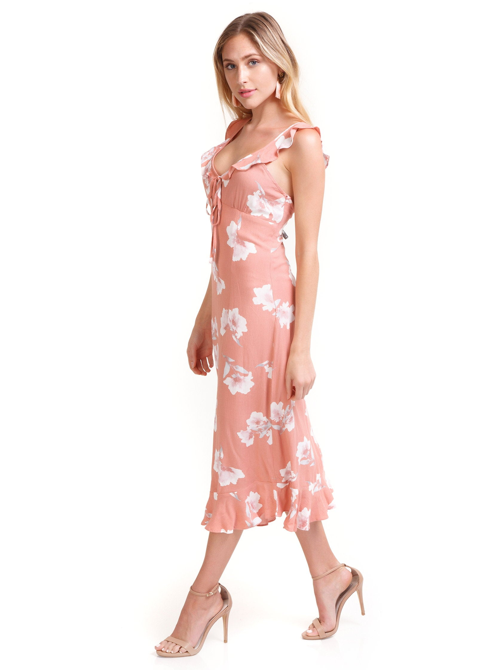 Woman wearing a dress rental from Cotton Candy called Sweet Floral Dress