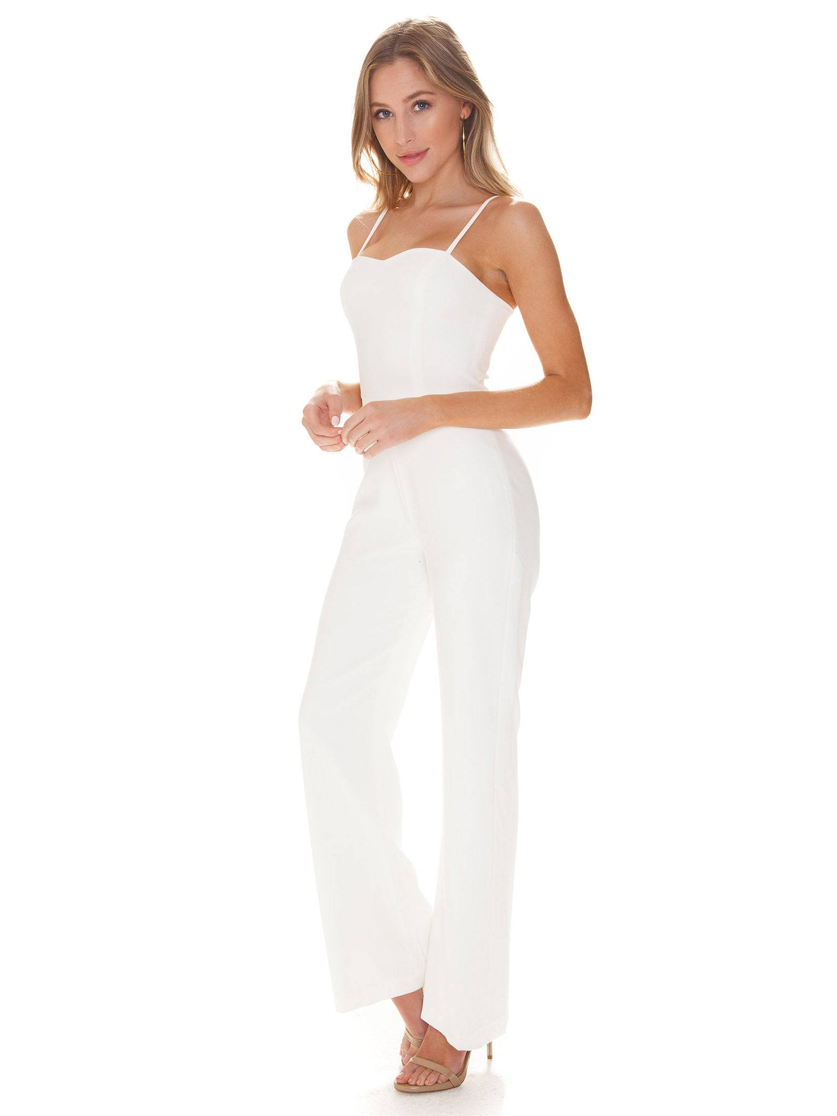 Woman wearing a jumpsuit rental from French Connection called Sweetheart Whisper Jumpsuit