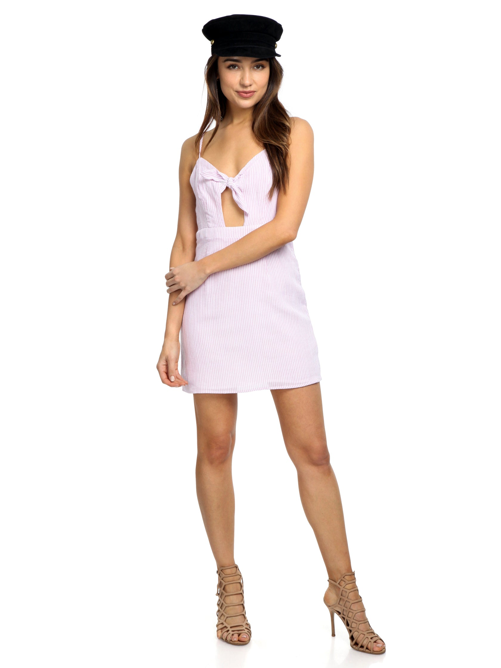 Women outfit in a dress rental from FashionPass called Swept Away Mini Dress