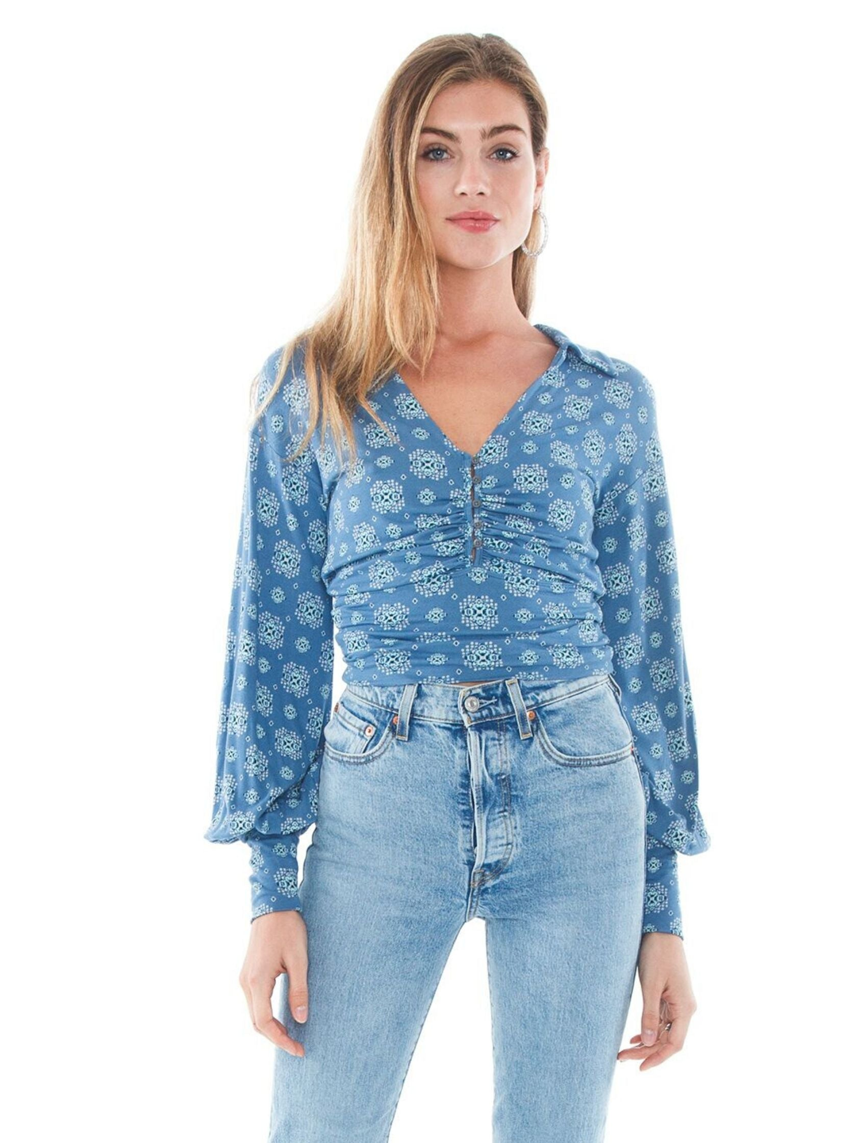 Woman wearing a top rental from Free People called Sydney's Printed Top