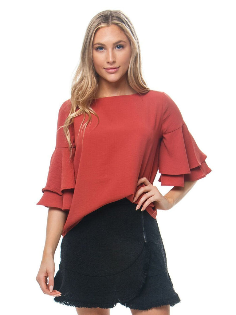 Woman wearing a top rental from BB Dakota called Tiger Lily Bell Sleeve Top