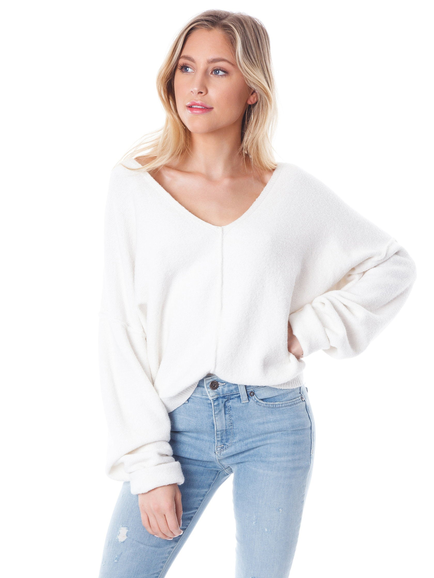 Woman wearing a sweater rental from Free People called Take Me Places Pullover