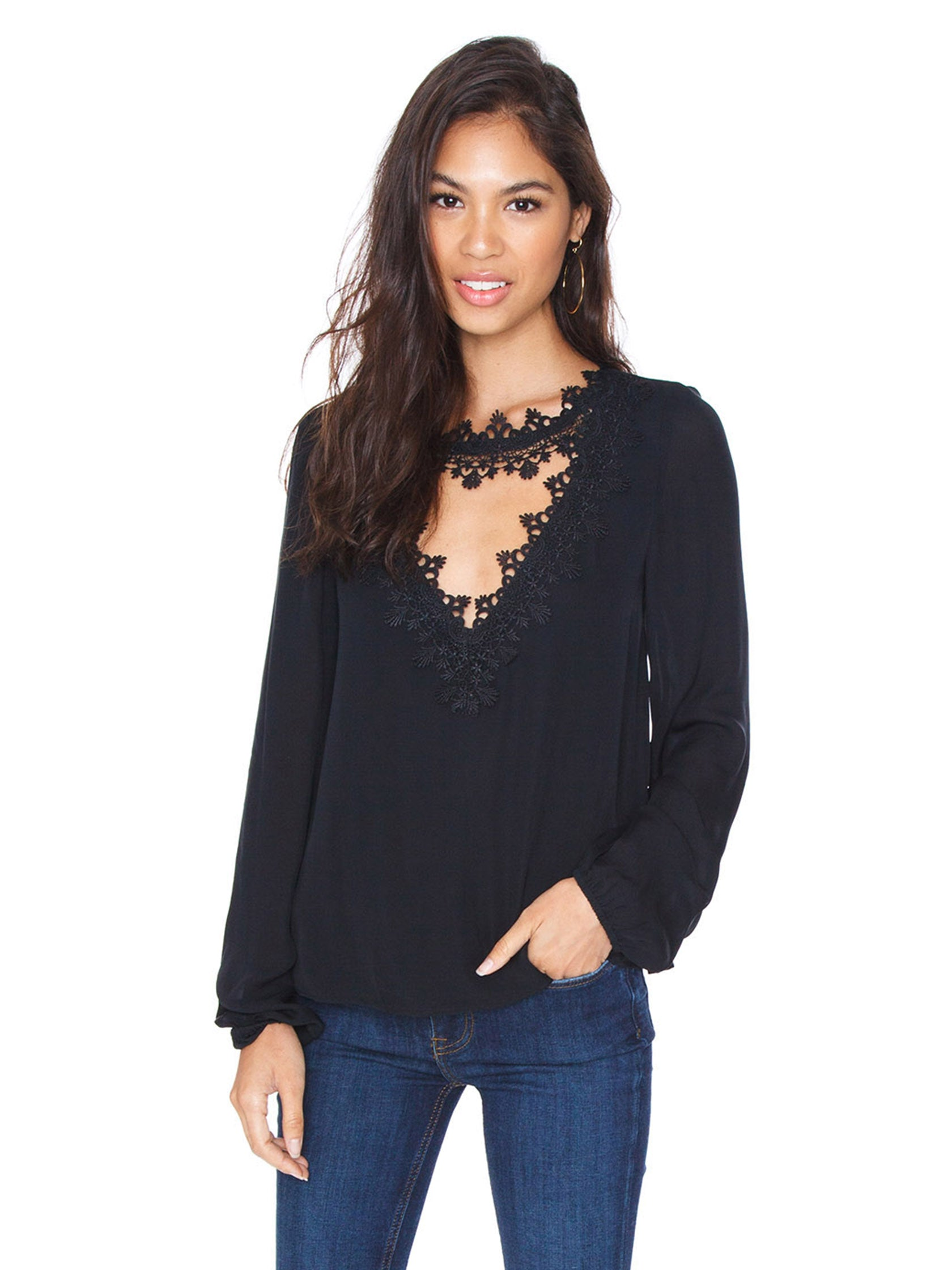 Woman wearing a top rental from Cami NYC called Tali Silk Blouse
