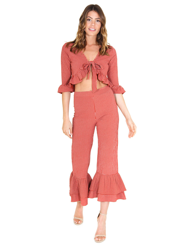 Woman wearing a two piece rental from FashionPass called Desert Sky Jumpsuit