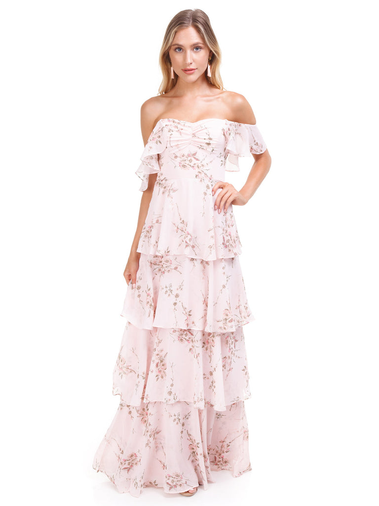 Woman wearing a dress rental from WAYF called Jamie Ruffle Wrap Gown