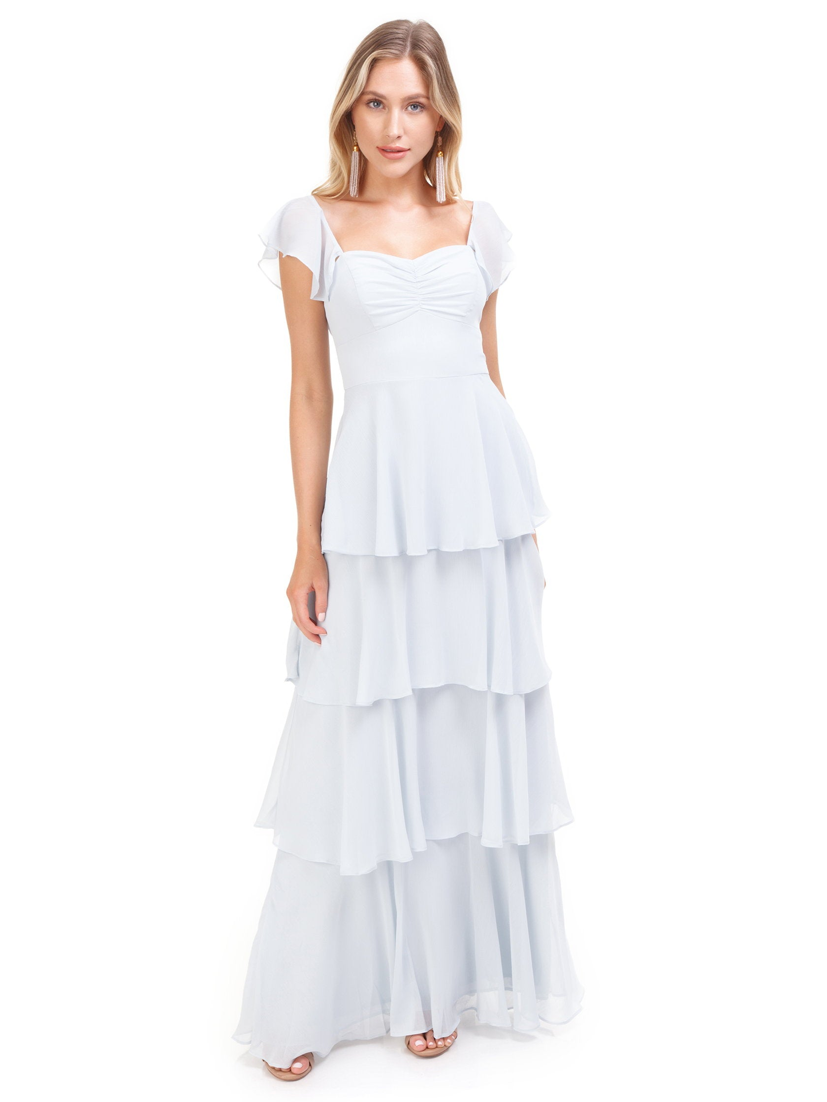 Girl outfit in a dress rental from WAYF called Abby Off Shoulder Tiered Maxi Dress